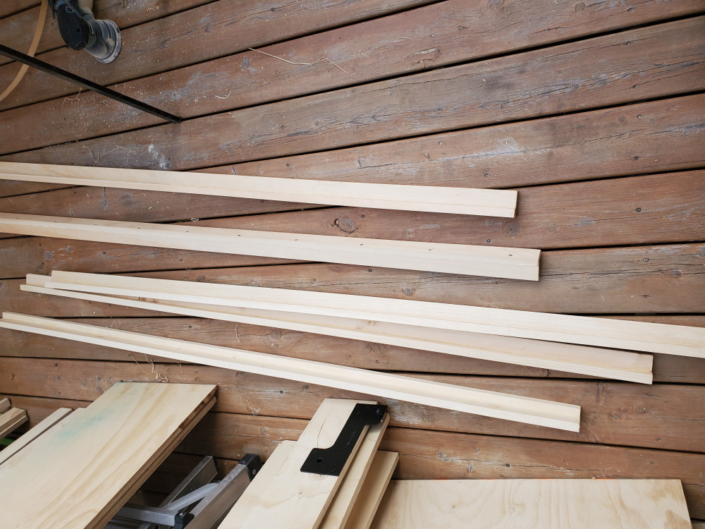 frame struts for diy wall bed made from 1x2 pine strips