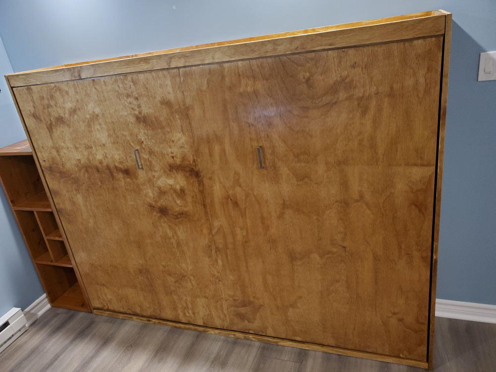 horizontal plywood murphy bed in small room